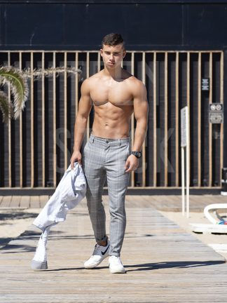 Cool boy with a beautiful body and strong muscles looks sexy