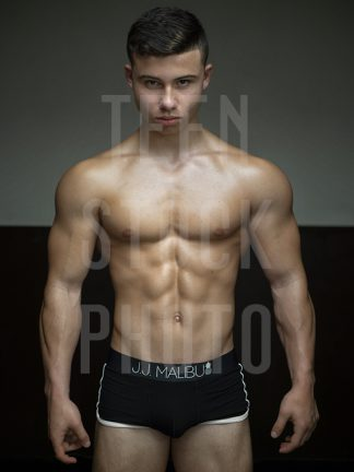 Fitness boy with a perfect body and muscles